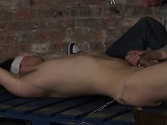 Ashton ties up Dylan cock and gives it a wank until he cums