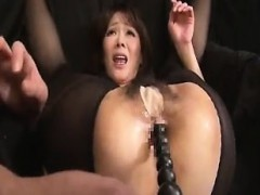 Luscious Asian milf takes a long dildo deep inside her tigh