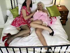 British mature lady in stockings licks blondes pussy