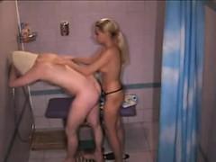 Blonde girl surprises her boyfriend in the shower