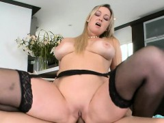 Busty mature chick is engulfing on dude's pecker hungrily