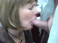 Hot mature secretary drops to her knees and blows a cock in