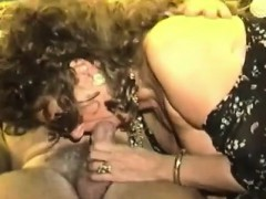 Alluring mature woman with big breasts strokes and sucks a