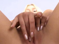 Innocent kitten is gaping pink cunt in close-up and getting