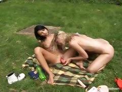 Lesbian fun on the grass