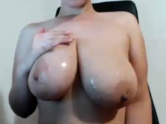 Brunette squeezes her big boobs with perky nipples and moans