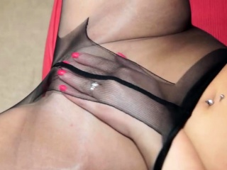 Chick in nylons plays with a dildo
