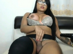 Busty latina shemale in stockings masturbates