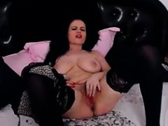 Busty huge tit milf fingers and rubs her pussy